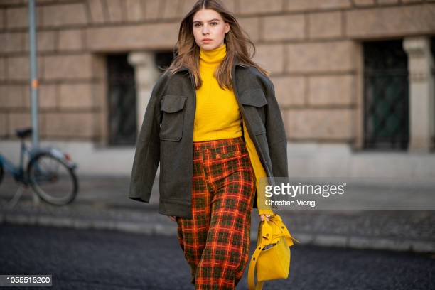 Swantje Soemmer is seen wearing yellow mustard sweater Stefanel grey jacket Edited plaid cropped pants Zara yellow mustard bag Sophie Hulme blue No...