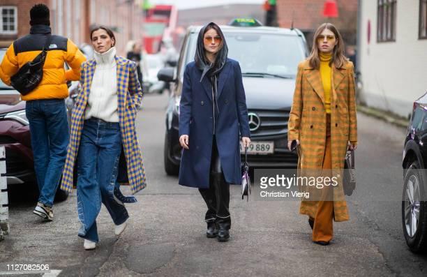 Swantje Soemmer is seen wearing yellow plaid coat Lena Lademann and Liberta Haxhikadriu is seen wearing flared denim jeans with slit plaid coat...