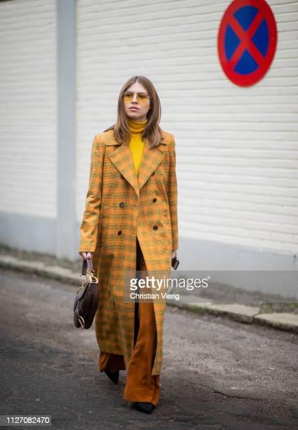 Swantje Soemmer is seen wearing yellow plaid coat outside Baum und Pferdgarten during the Copenhagen Fashion Week Autumn/Winter 2019 Day 3 on January...