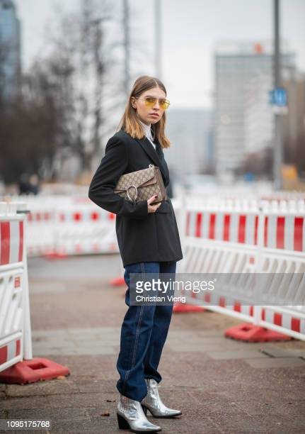 Swantje Soemmer wearing belted blazer jacket, denim jeans, silver boots, Gucci bag seen during the Berlin Fashion Week Autumn/Winter 2019 on January...