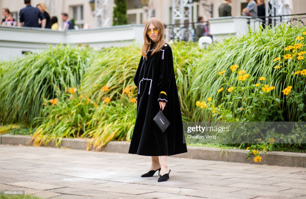 Swantje Soemmer wearing black dress, bag with print pouch seen outside Der Berliner Salon during the Berlin Fashion Week July 2018 on July 6, 2018 in Berlin, Germany.