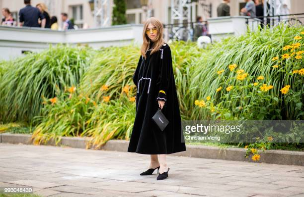 Swantje Soemmer wearing black dress bag with print pouch seen outside Der Berliner Salon during the Berlin Fashion Week July 2018 on July 6 2018 in...