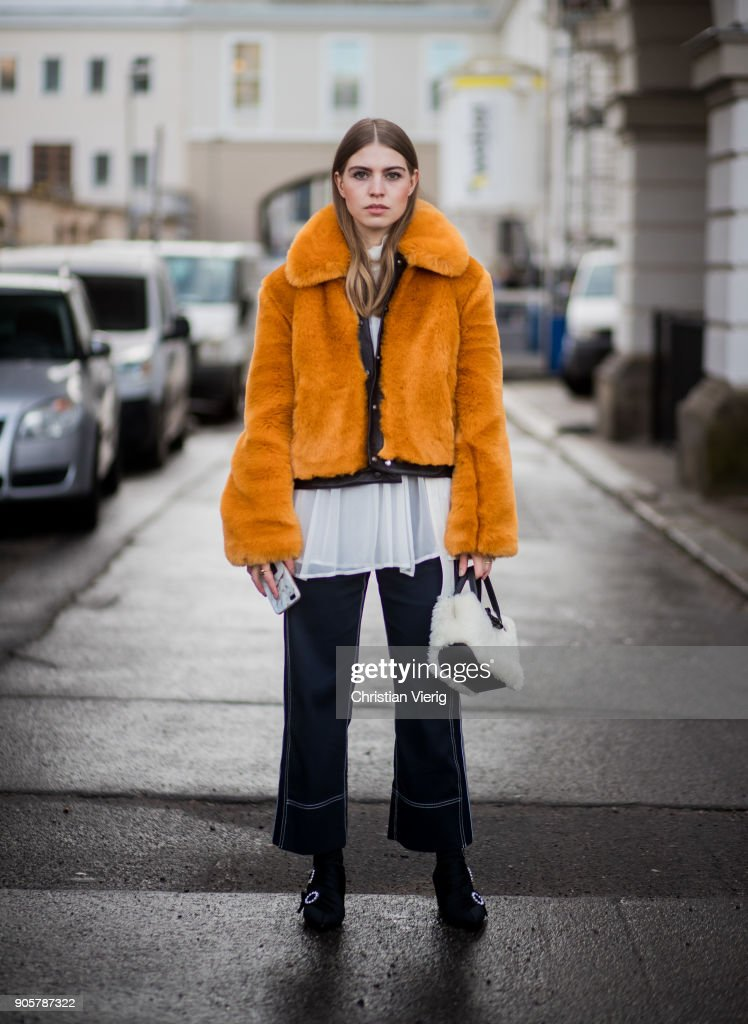 Swantje Soemmer wearing yellow H&M trend jacket, blouse and pants Sportmax, Longchamp bag, Zara ankle boots is seen outside Der Berliner Modesalon during the Berlin Fashion Week January 2018 on January 16, 2018 in Berlin, Germany.