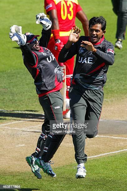 Swapnil Patil and Amjad Javed of the United Arab Emirates celebrate after taking the wicket of Hamilton Masakadza of Zimbabwe during the 2015 ICC...