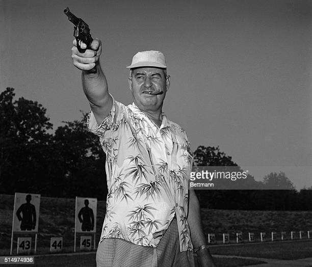 Swapping his Air Force uniform for a bright sport shirt General Curtis LeMay Head of the U S Strategic Air Command sharpens his shooting eye with...
