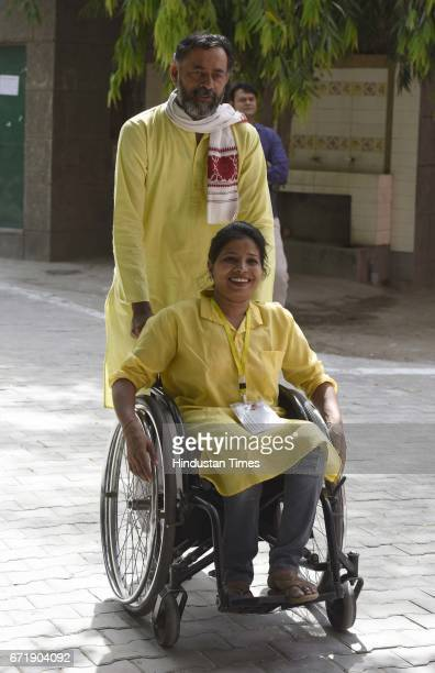 Swaraj India Party Chief Yogender Yadav with his party candidate arrives to cast the vote during the MCD elections 2017 in East Delhi polling station...