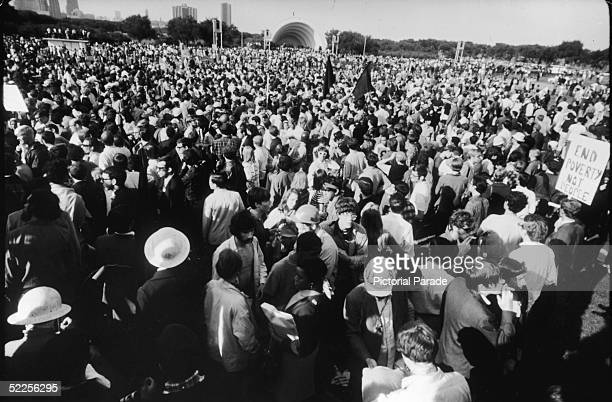 A swarm of antiVietnam War protestors gather in a park to protest the 1968 Democratic National Convention Chicago Illinois August 1968