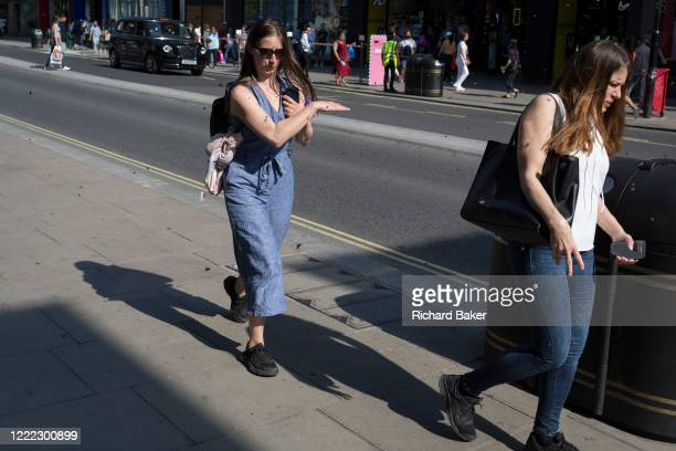 A swarm of bees disrupt worried shoppers on London's Oxford Street on the day that UK Prime Minster Boris Johnson announced in parliament a major...