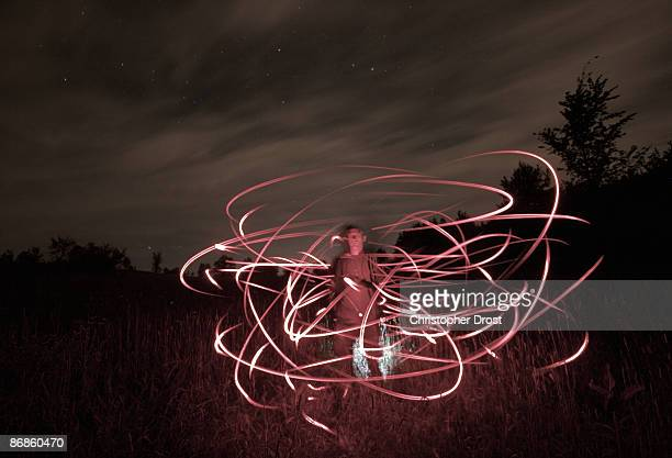 swarm - firefly stock pictures, royalty-free photos & images