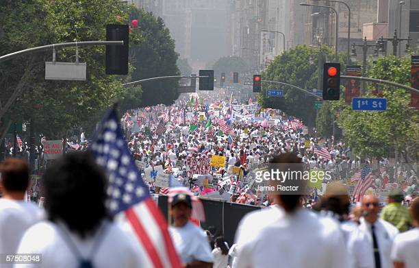 Swarms of people march down Broadway in support of immigrant rights May 1 2006 in downtown Los Angeles California Immigrants and their supporters...