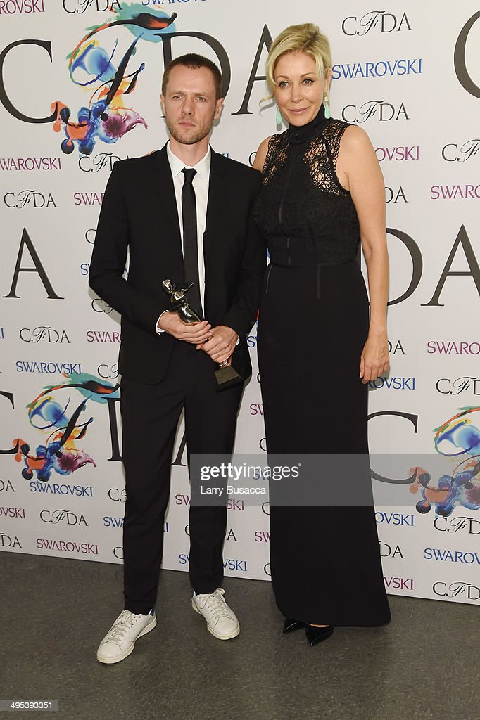 Swarovski award for Menswear recipient Tim Coppens and Nadja Swarovski attend the winners walk during the 2014 CFDA fashion awards at Alice Tully Hall, Lincoln Center on June 2, 2014 in New York City.