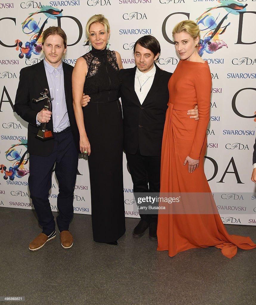 Swarovski Award for Womenswear award recipients Shane Gabier and Christopher Peters of Creatures of the Wind pose with Nadja Swarovski and Greta Gerwig at the winners walk during the 2014 CFDA fashion awards at Alice Tully Hall, Lincoln Center on June 2, 2014 in New York City.