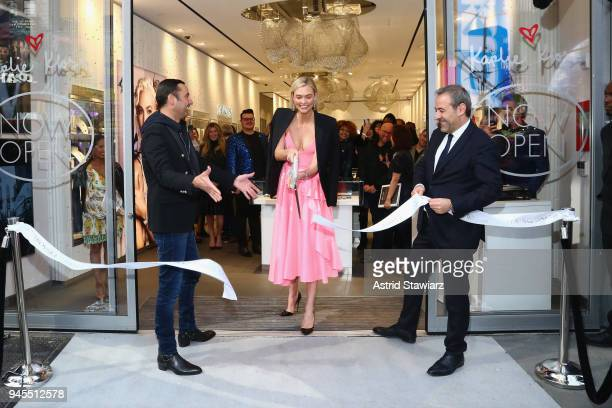 Swarovski brand ambassador Karlie Kloss cuts the ceremonial ribbon at the brands latest flagship location in New York Citys Times Square in honor of...
