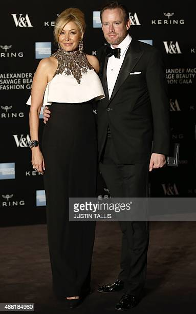 Swarovski CEO Nadja Swarovski and husband Rupert Adams pose for pictures as they arrive on the red carpet for the 'Alexander McQueen Savage Beauty...