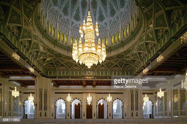 swarovski crystal chandelier hangs from main dome - sultan qaboos mosque stock pictures, royalty-free photos & images