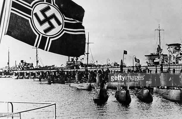 A swastika flag waves over a harbor for German submarines