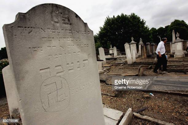 A swastika is daubed on a Jewish gravestone in Eastham Jewish cemetery June 16 in London England AntiSemitic vandals have desecrated gravestones and...