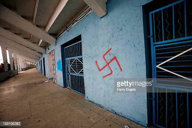 A swastika is seen graffitied on a wall in the Volgograd football stadium on November 16 2011 in Volgograd Russia The stadium is due to be overhauled...