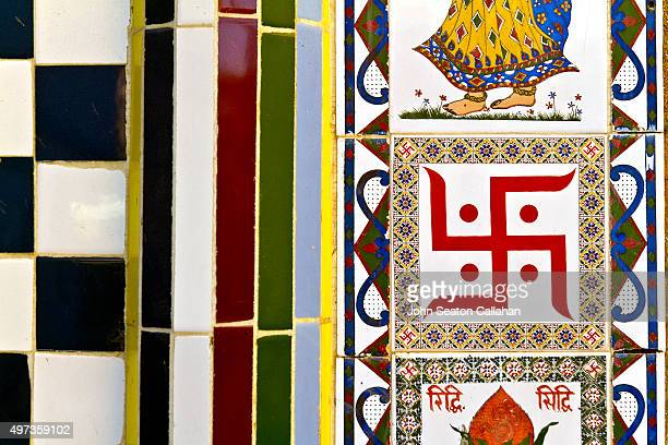 swastika symbol and decor at hindu temple - nazi flag stock pictures, royalty-free photos & images
