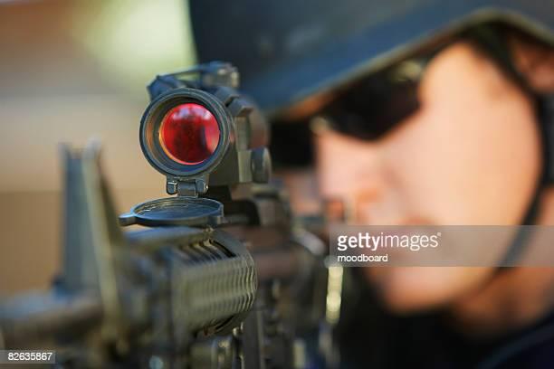 swat officer aiming gun - machine gun stock pictures, royalty-free photos & images
