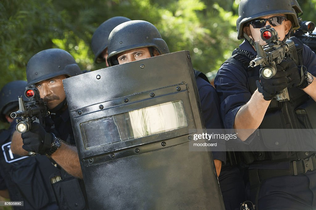Swat officers with gun and shield : Stock Photo
