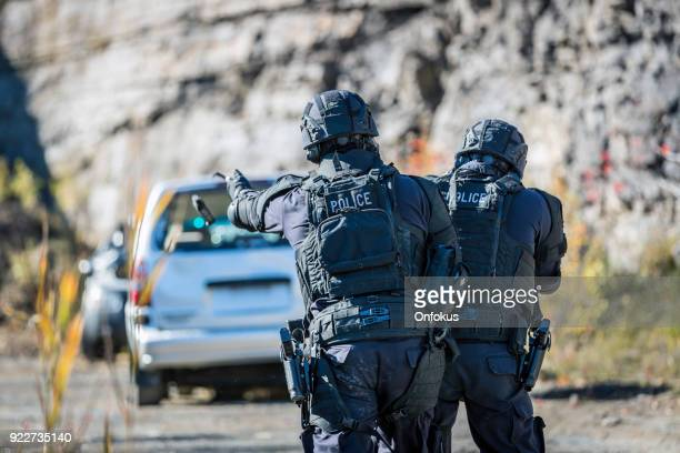 swat police officers shooting with firearm - hand grenade stock pictures, royalty-free photos & images