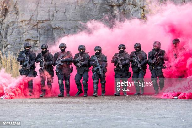 swat police officers shooting with firearm - task force stock pictures, royalty-free photos & images
