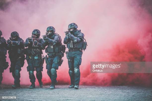 swat police officers shooting with firearm - terrorism stock pictures, royalty-free photos & images