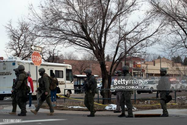 Swat team personnel walk outside the King Soopers grocery store in Boulder, Colorado on March 22, 2021 after reports of an active shooter. - A gunman...