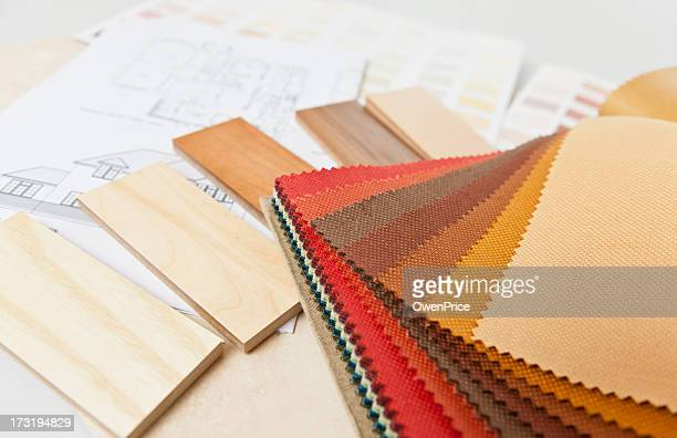 Swatches of fabric samples and wood finishes for interiors