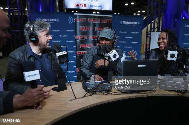 Sway Calloway center hosts Sway in the Morning his daily show on Eminem's Shade 45 channel live from the SiriusXM set at Super Bowl LI Radio Row with...