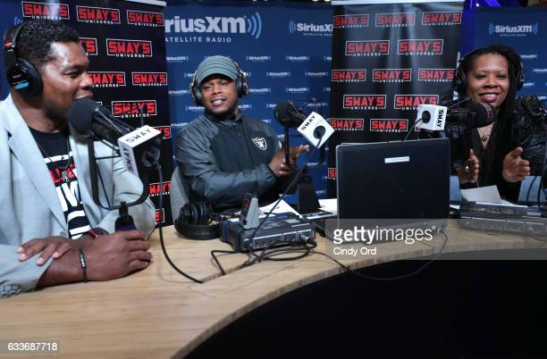 Sway Calloway second from left hosts Sway in the Morning his daily show on Eminem's Shade 45 channel live from the SiriusXM set with Herschel Walker...
