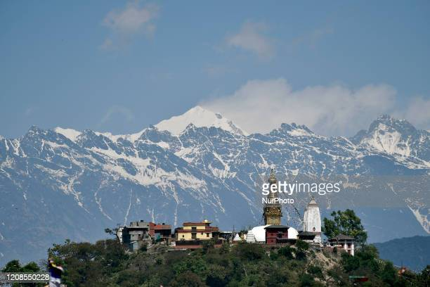 Swayambhunath Stupa and in background beautiful Mt. Langtang ranges seen from Kathmandu during the sixth day nationwide lockdown as concerns about...