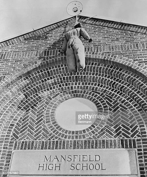 Swaying grotesquely above the entrance of Mansfield High School is the effigy of a Negro which greeted school children on the second day of...