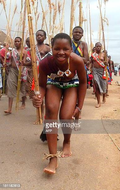 Swazi girl carries reeds on September 2 2012 as she arrives to dance for King Mswati III at the Ludzidzini royal palace in Mbabane Over 60000 maidens...