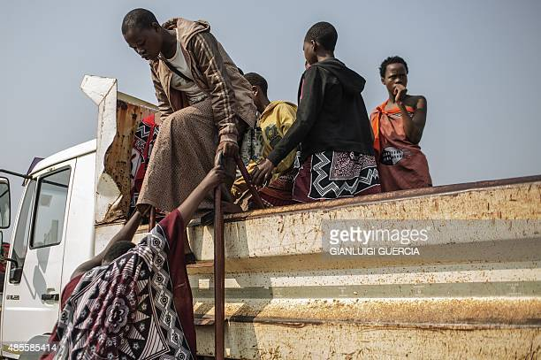 Swazi girls arrive in trucks before walking to the Royal palace two day ahead of the traditional reed dance on August 28 2015 on the outskirts of...