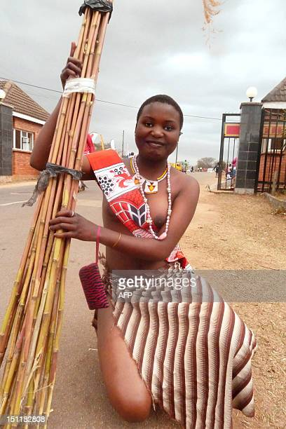 Swazi girls carries reeds on September 2 2012 as she arrives to dance for King Mswati III at the Ludzidzini royal palace in Mbabane Over 60000...