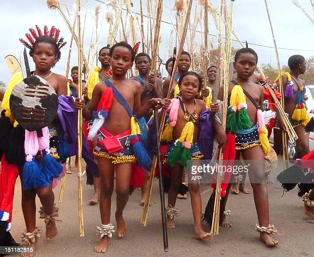Swazi girls carry reeds on September 2 2012 as they arrive to dance for King Mswati III at the Ludzidzini royal palace in Mbabane Over 60000 maidens...