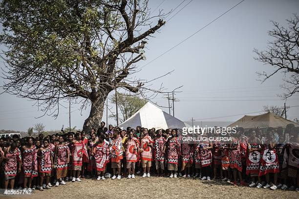 Swazi girls dance and sing as they get ready to walk to the Royal palace two days ahead of the traditional Reed Dance on August 28 2015 on a farm in...