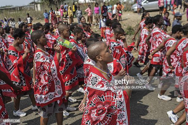 Swazi young girls dance and sing as they walk to the Royal palace two day ahead of the traditional reed dance on August 28 2015 on a farm in the...