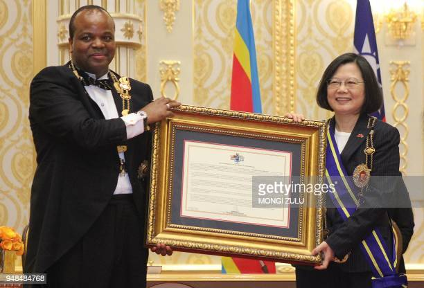 Swaziland absolute Monarch King Mswati III poses with Taiwan President Tsai Ingwen after awarding her with the Order of the Elephant during her visit...