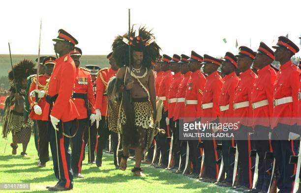 Swaziland King Mswati III inspects the guard of honor at the celebration of his 30th birthday which coincides with the 30th anniversary of Swazi...