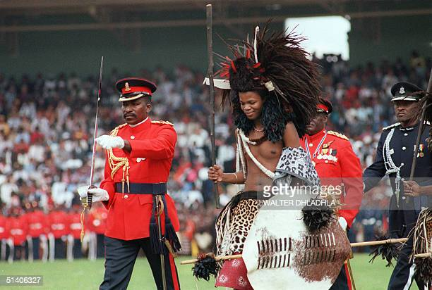 Swaziland new King Mswati III, who succeeded his father King Sobhuza II, who died in 1982 at the age of 82, smiles to the crowd during his coronation...