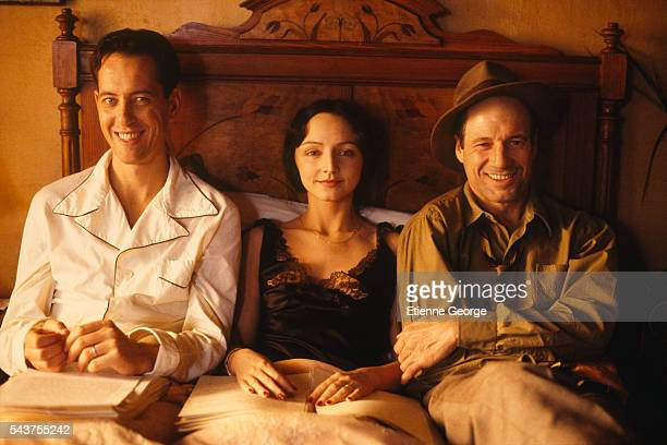 Swaziland-born actor Richard E. Grant, Portugese actress Maria de Medeiros and American actor Fred Ward on the set of the film 'Henry & June', directed by Philip Kaufman and based on French writer Anais Nin's novel by the same title.