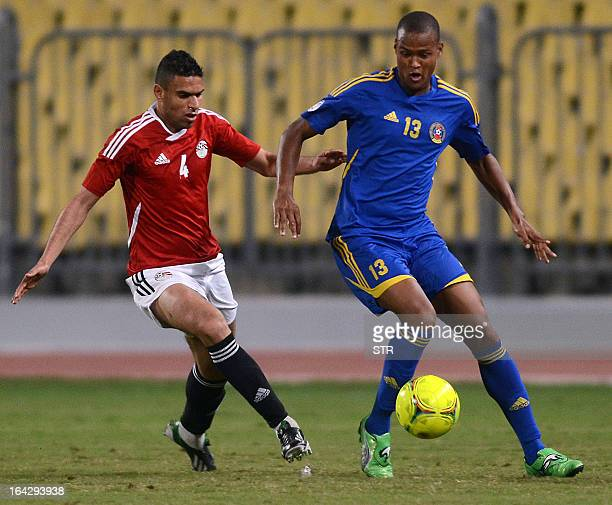 Swaziland's Barry Steenkamp challenges Egypt's Ahmed Said Okka during their friendly football match in the Egyptian coastal city of Alexandria on...