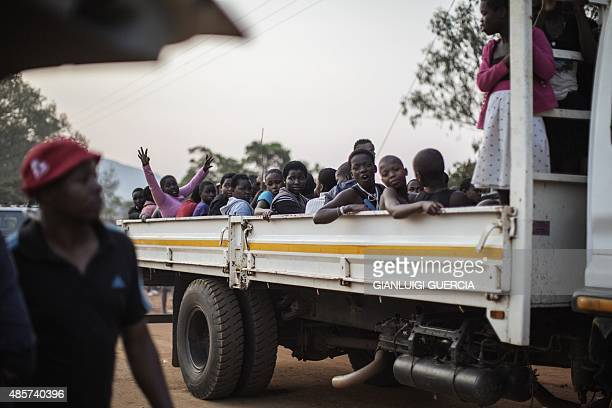 Swaziland's girls dance and sing as they arrive on the back of a truck to the area surrounding Ludzidzini Royal palace one day ahead of the...