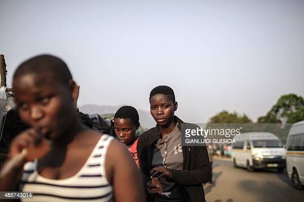 Swaziland's girls shop and stroll through a makeshift market in the surroundings of the Ludzidzini Royal palace one day ahead of the traditional reed...
