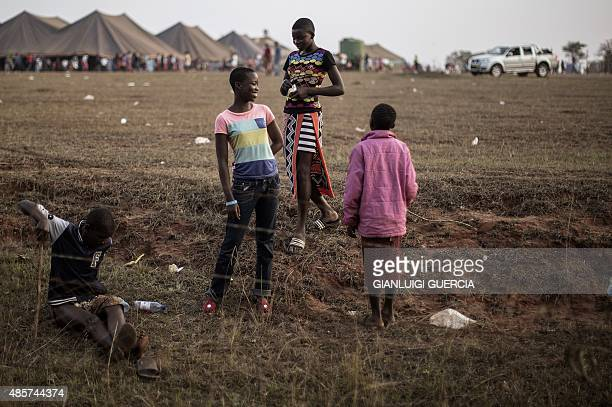 Swaziland's girls walk through a fields by makeshift tents where thousands of them will sleep for the next two nights in the surroundings of the...