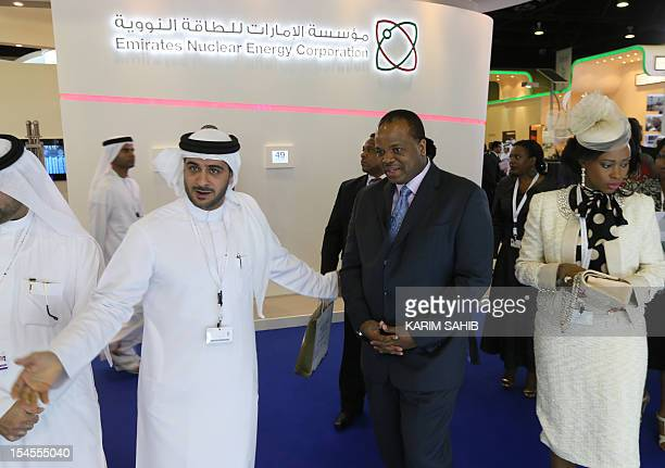 Swaziland's King Mswati III and his wife Inkhosikati LaMbikiza listen to an explanation by an exhibitor during their tour to WEF Exhibition during...