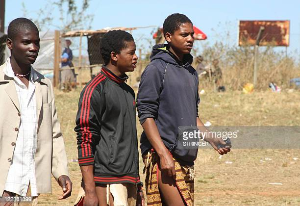 Swaziland's men and boys hang around outside the camps to entice teenage girls out on dates during the traditional Umhlanga ceremony known as the...